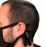 OhioTRUE Cloth Face Mask tied behind ears on model, side view