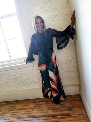 Large tropical floral print on wide legged, palazzo type pants.