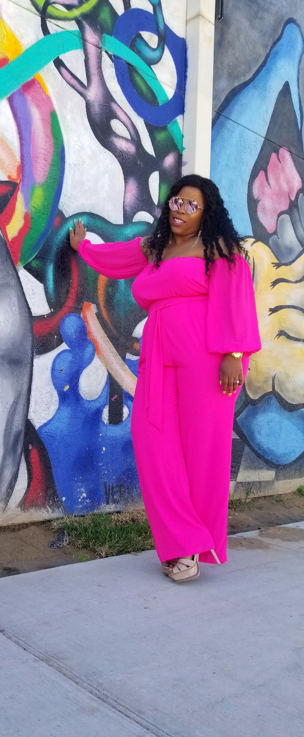 Haute NEON Pink jumpsuit.  Elastic bandeau designed with off the shoulder long sleeves attached.  Fully lined upper and bottom with a Chiffon overlay.