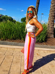 ilac pants with color blocking neon orange and yellow side stripes.  Ankle length that will be perfect to wear with flats or to simply show off your summer shoe game.