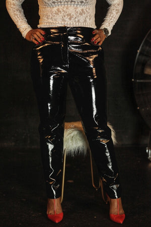 This pair of faux leather pants has a liquid glossy finish appearance, hence the name Liquid Fiyah. Side slanted pockets with a zipper and hook closure.  Discover why you'll need to rock these right now.
