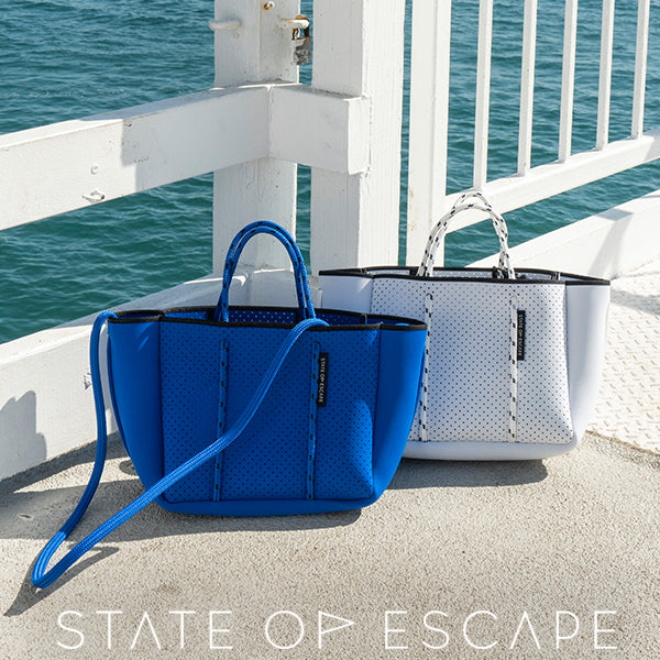 State of Escape Neoprene Handbag Collection