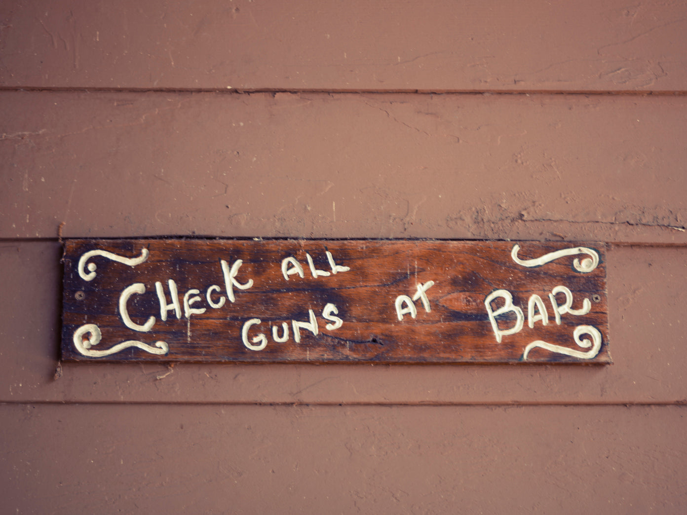Check All Guns at the Bar