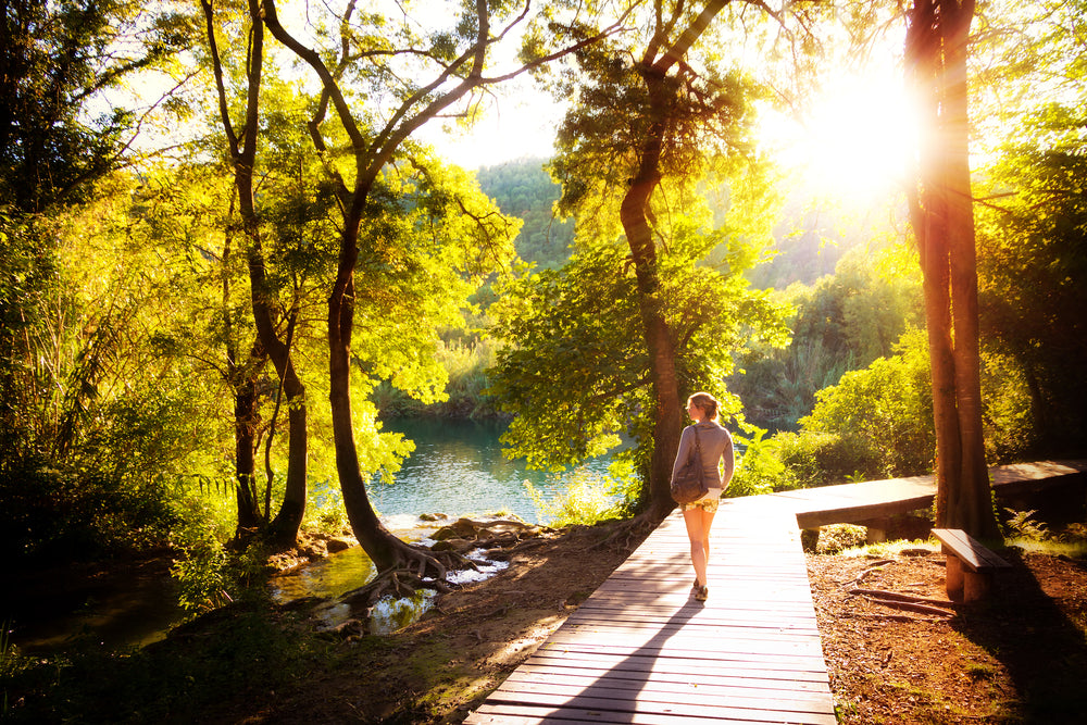 Young woman walks in Krka national park in Croatia at sunset