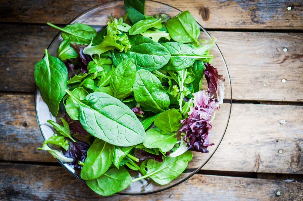 Fresh green salad with spinach, arugula, romaine and lettuce