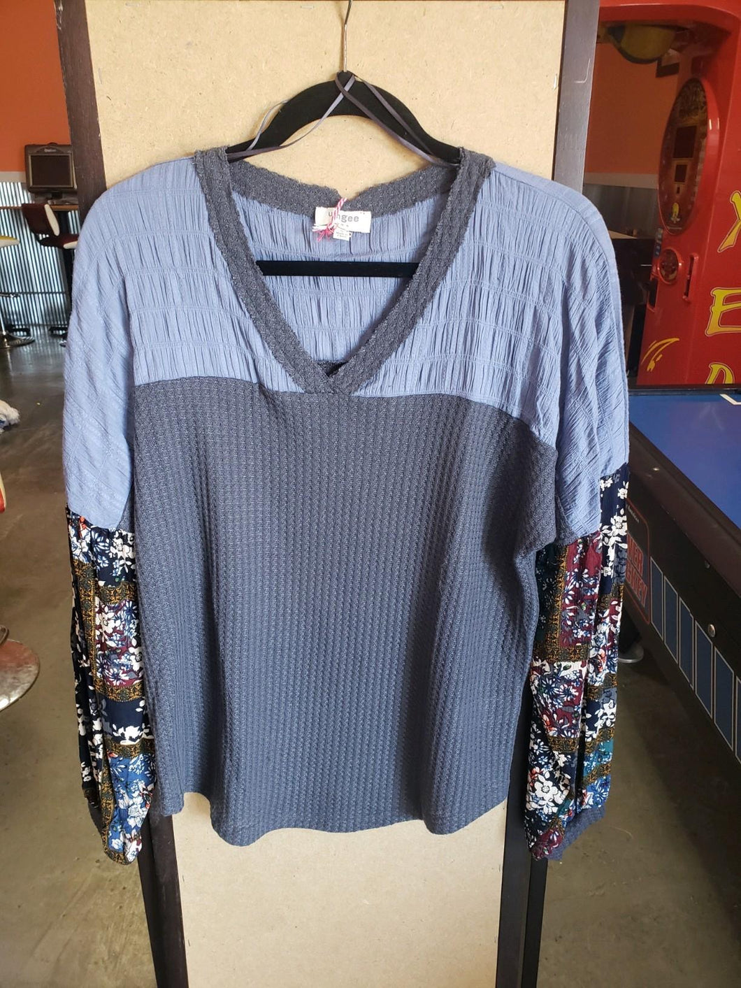 Blue and grey top with patterned sleeves
