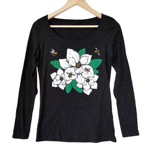 Magnolia & Honey Bees Women's T-shirt. Stay warm this fall with our gorgeous new long sleeve shirts. Featuring our new original design that captures the beauty of the Southern Magnolia and bees collecting pollen. So realistic, you can smell the sweetness.   Buttery soft triblend, preshrunk, true to size.  We gift a package of pollinator wildflower seeds with every shirt purchase. Help provide nectar, pollen and shelter to our beloved pollinators.   We Love Bees!!