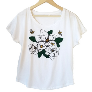 Magnolia & Honey Bees Women's T-shirt. We've created a beautiful new design that captures southern style, charm and our love of bees. Magnolia's are one of our favorites and this design is so realistic, you can almost smell the sweetness.  Silky soft cotton/poly blend, true to size dolman, tearaway label.  FREE package of wildflower seeds with your order.