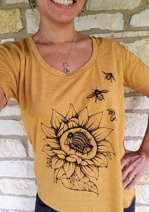 Gold Sunflower & Bees T-shirt. Ready for Spring yet? Slip into this ultra soft festival scoop neck in the hottest color of the season. Relaxed fit and light weight with the beauty of bees.  True to size, pre-shrunk, tri-blend.