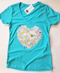 Tahitian Blue Daisy Women's T-shirt. This is your new go-to shirt. Pairs easily with any outfit, soft material with an original design. No more silly bee shirts, feel confident and look great.   Cotton/poly blend, laundered, tearaway label, form fitted v-neck.