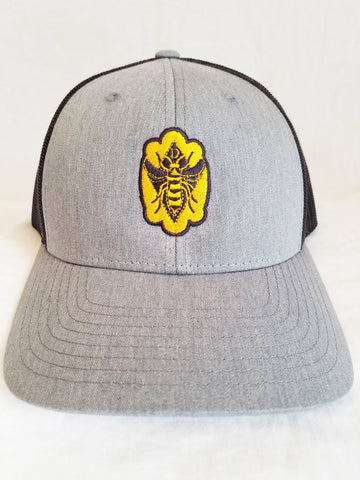 Decker Honeybees Logo Trucker Hat. Our hats come in 2 color combinations, match with your mood or outfit. No more bad hair days or frumpy hats. Step out looking strong and beautiful.  Grey/black and Pink/black Hat:  Structured, low-profile, six-panel Pre-curved visor Adjustable plastic snapback