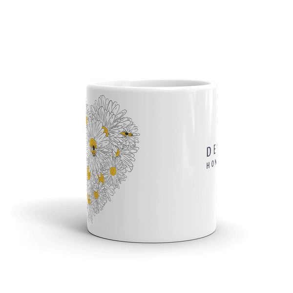 Decker Honeybees Daisy Heart Mug. Whether you're drinking your morning coffee, your evening tea, or something in between – this mug's for you! It's sturdy and glossy with beautiful original art that'll withstand the microwave and dishwasher. Just add honey! Ceramic. Dishwasher and microwave safe. White and glossy