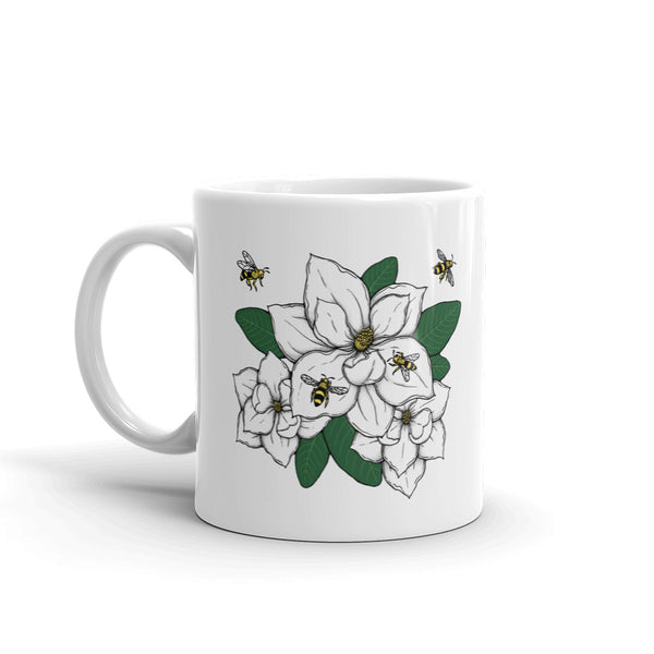 Decker Honeybees Magnolia Mug. Whether you're drinking your morning coffee, your evening tea, or something in between – this mug's for you! It's sturdy and glossy with our new original design. Just add honey! Ceramic. Dishwasher and microwave safe. White and glossy