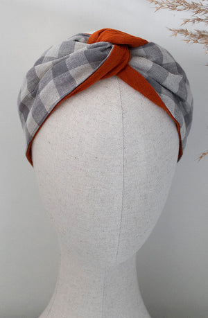 checked grey and orange headband on mannequin