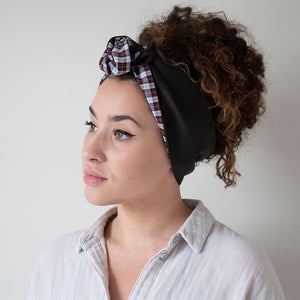 woman wearing double sided checkprint headband