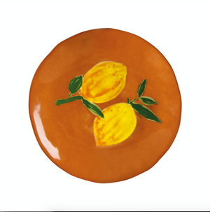 image of &klevering lemon plate on brown background