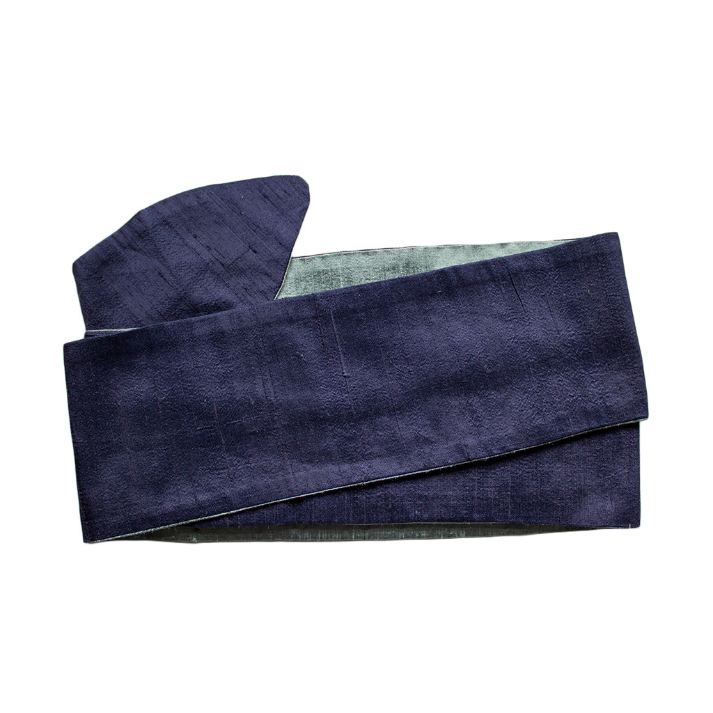 cloth label long blue silk headband on white background