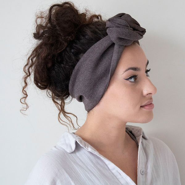 woman wearing a brown jersey wool and silk fabric headband by coffee & cloth