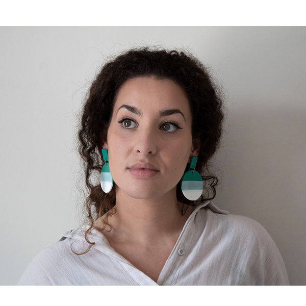woman wearing azadeh francesca style earrings in jade green colour
