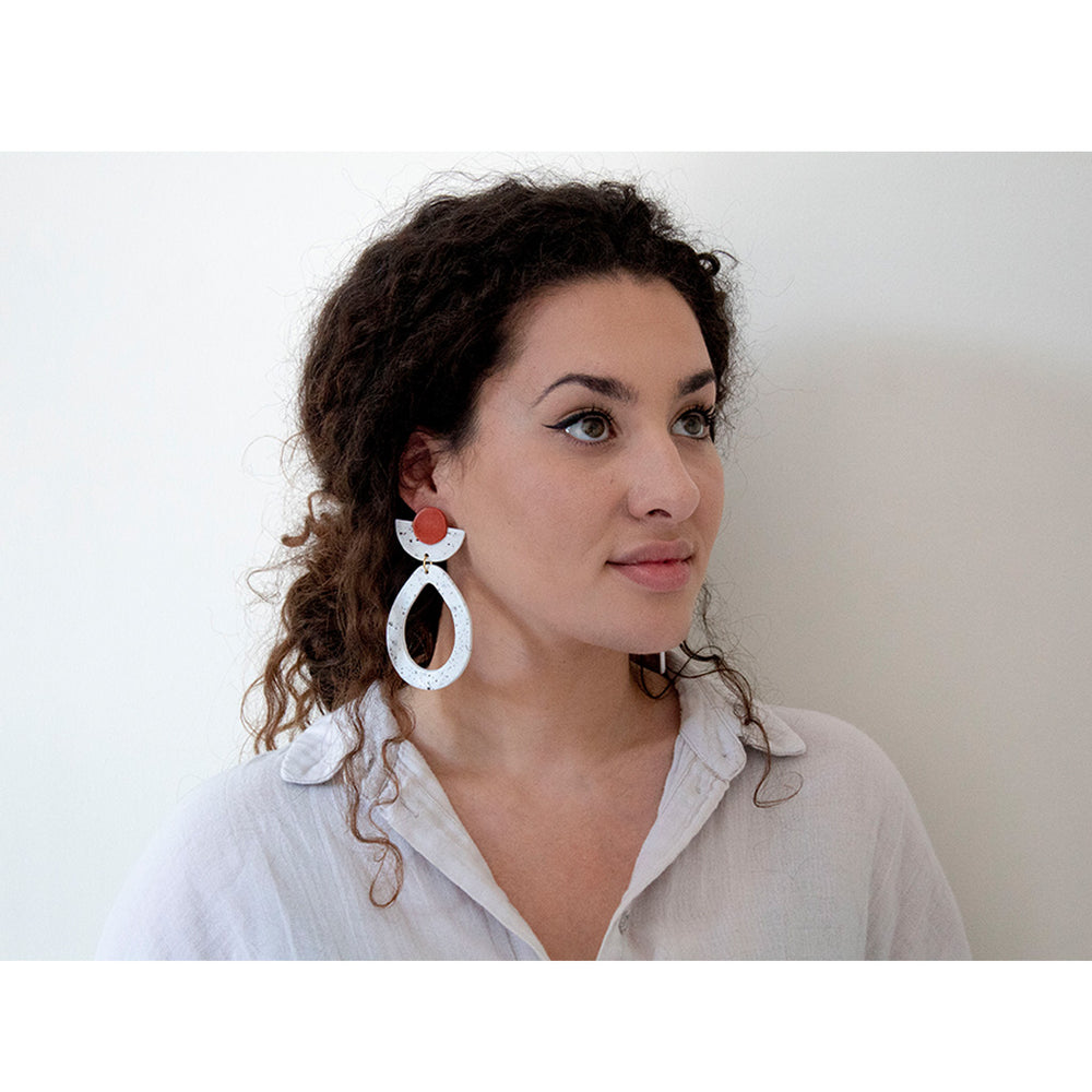 woman wearing Azadeh Statement Earrings Maya