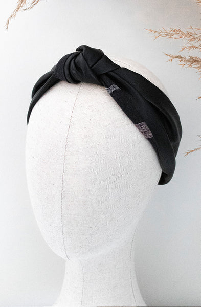 Single knot black faux leather & check combo headband on mannequin