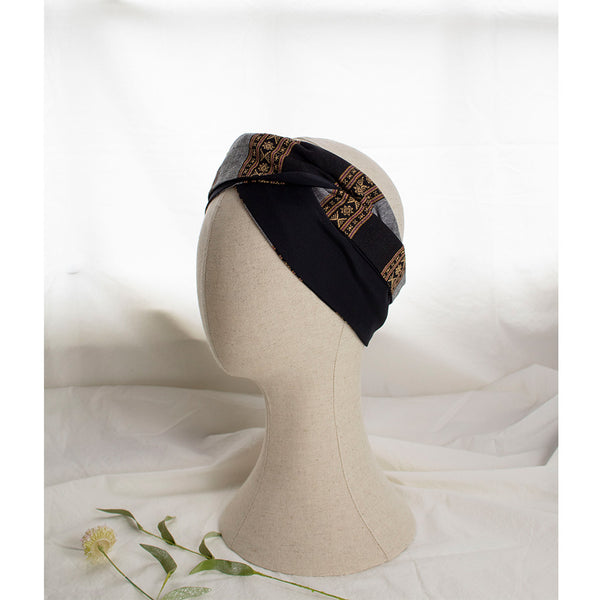 Navy blue and grey headband notte styled on a mannequine head