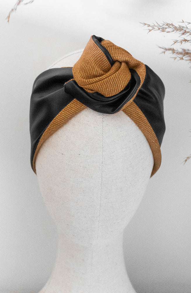 black leather and gold thread woven fabric headband on mannequin