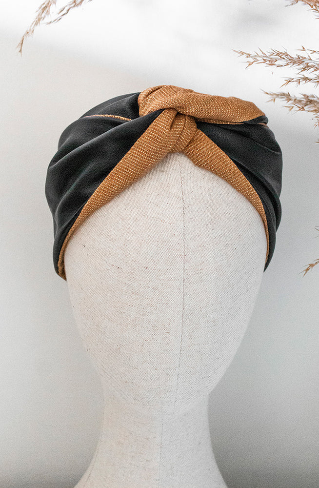 black leather and gold thread woven fabric headband styled on mannequin head