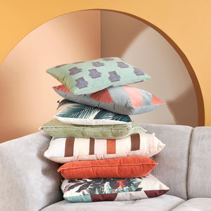 picture of HK Living Cushions stacked on a sofa