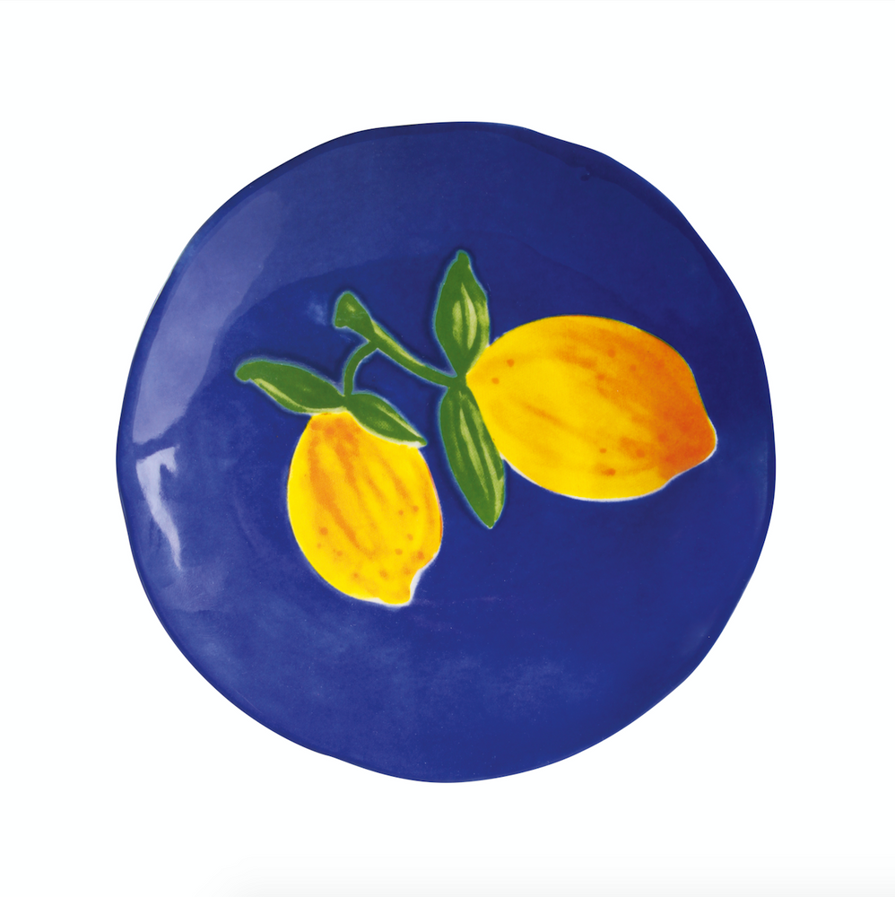close up of klevering lemon plate in blue background