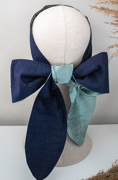 cloth label long blue silk headband on mannequin head