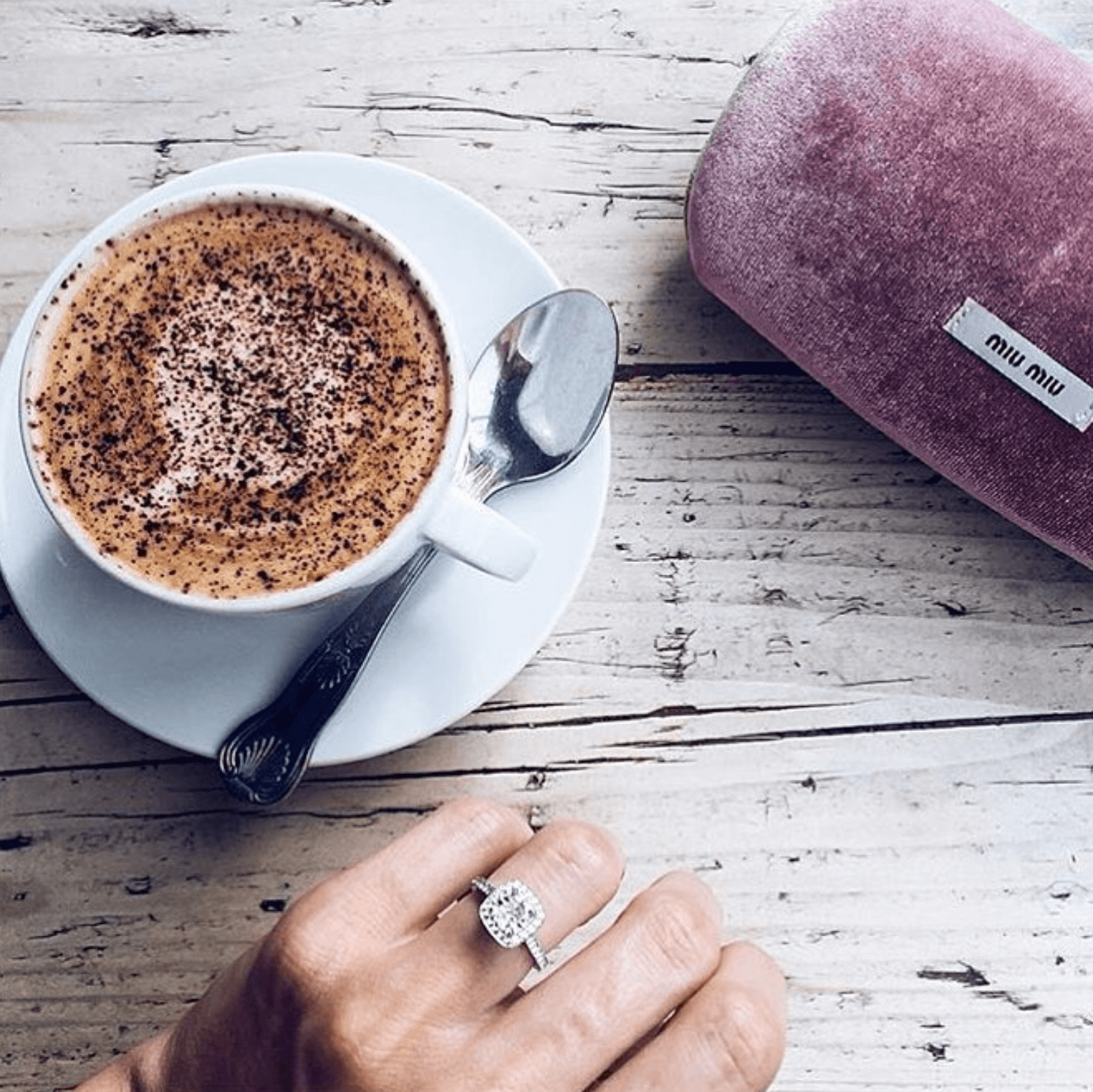 Art Deco inspired engagement ring photo with coffee