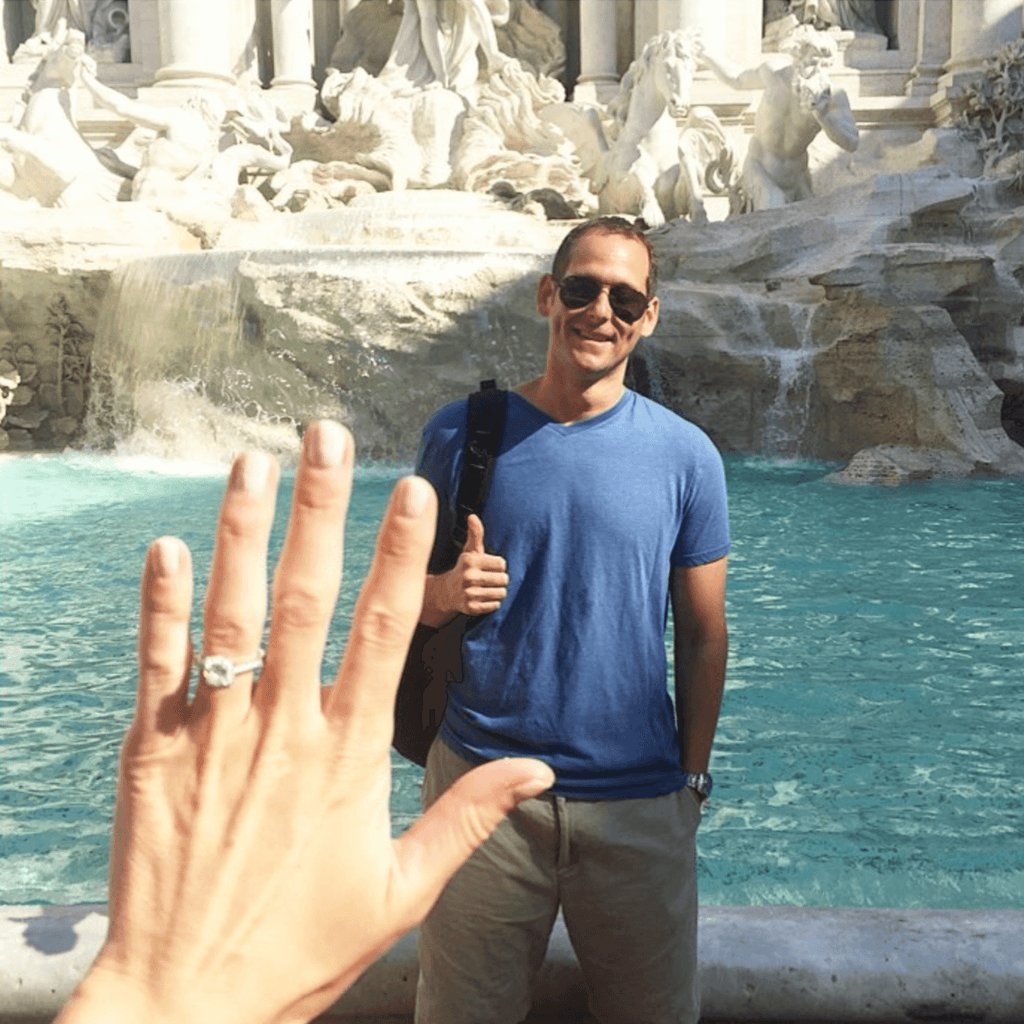 Romen proposal by the Trevi Fountain, showing diamond engagement ring