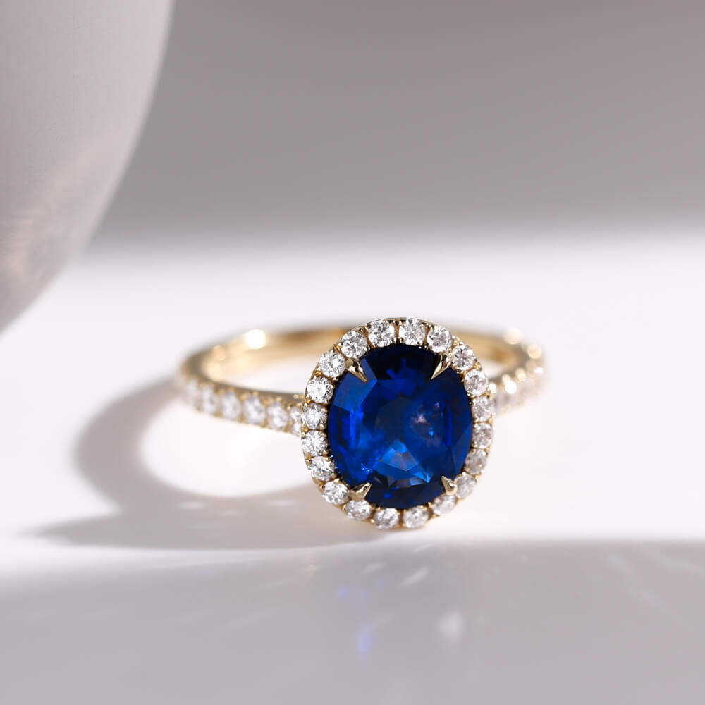 Large blue sapphire bespoke engagement ring hand crafted in Hatton Garden