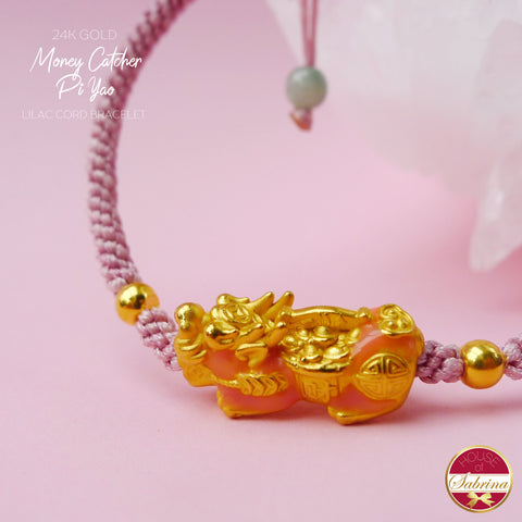 24K GOLD PEACH PI YAO ON LILAC CORD BRACELET