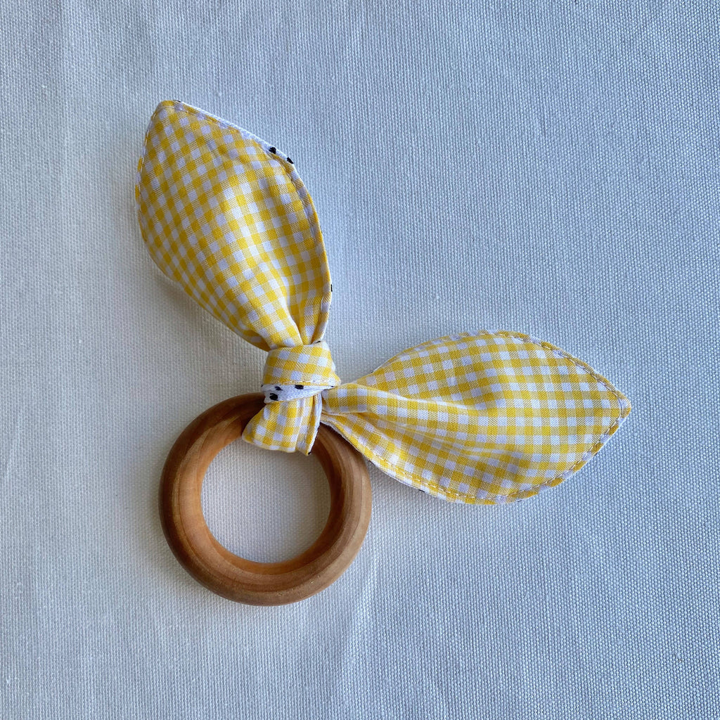 Wooden teething ring tied with fabric bunny ears