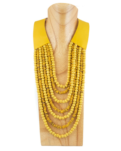 Multi-strand bead necklace with wide leather closing and wooden clasp. One size. Mustard colour.