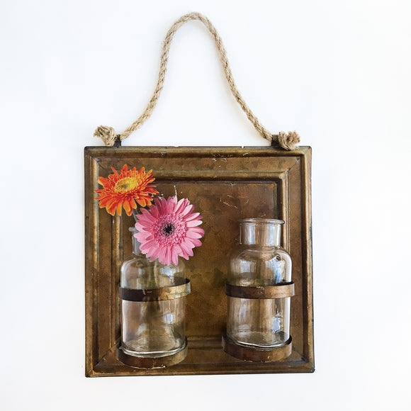 Glass jars on copper plaque