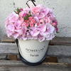 Pink hydrangea and mini roses in a hat box