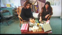Two women packing beauty products in boxes on BBC Northwest news