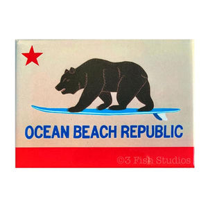 By 3 Fish Studios. Beautiful, super strong Ocean Beach Republic Magnet, made in the USA. Ready for your fridge or file cabinet! Measures 2.5 x 3.5 inches. Also available in store at FOLD Gallery DTLA.