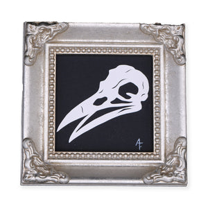 Crow Skull. Original Artwork by Ashley Fisher. It Measures 4 x 4 x 1 inches. Please note that due to everyone's monitor displaying differently, the colors you see may vary.