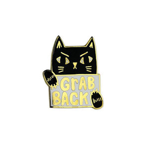 By Badge Bomb. Grab Back Pussy Cat Pin. Illustrated by Allison Cole. Gold hard enamel pin. Measures 1 inch.