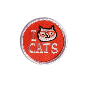 By Badge Bomb. Iron on I Cat Cats Patch by Gemma Correll. Comes packaged in individual hang bag. Measures 2.25 inches. Also available in store at FOLD Gallery DTLA.