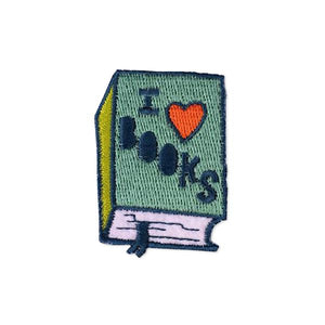 By Badge Bomb. Embroidered, felt, iron-on I Heart Books Patch by Allison Cole. Comes packaged in individual hang bag. Measures 1.5 x 2 inches. Also available in store at FOLD Gallery DTLA.