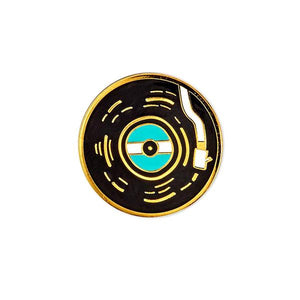 By Badge Bomb. Vinyl Record Pin. Gold hard enamel pin illustrated by Allison Cole. Measures 1 inch. Also available in store at FOLD Gallery DTLA.