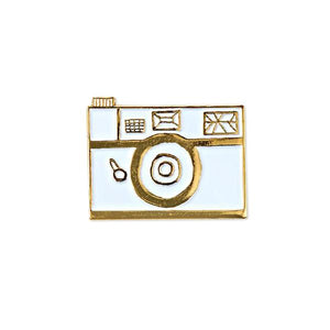 By Badge Bomb. White Retro Camera Pin. Soft enamel pin illustrated by Allison Cole. Measures 1.25 inches. FOLD Gallery Dtla.