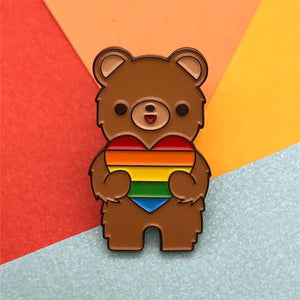 by Bored Inc. Show your pride with this limited edition CA Bear Love is Love Pin. We're proud to live in The Golden State - and one of those reasons is because California supports marriage equality. Love is Love. Comes with a black rubber clutch. Measures 1 inch. Also available in store at FOLD Gallery in DTLA.