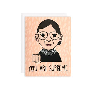 by Bored Inc. You Are Supreme RBG Ruth Bader Ginsburg Card. Tell your favorite gal she's SUPREME with this tribute to The Notorious RBG! Card is blank inside, comes with plain white envelope. Digitally printed using high quality, archival dye based inks on a heavyweight matte card. Measures 4 1/4 x 5 1/2 inches. FOLD Gallery Dtla.