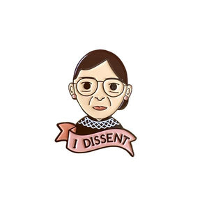 "by Bored Inc. Ruth Bader Ginsburg RBG ""I Dissent"" Pin. Soft enamel pin comes with black rubber clutch. Measures 1.25 inches. Also available in store at FOLD Gallery DTLA."